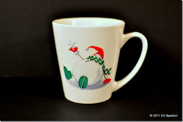 white cup, black background with exposure compensation plus 1 EV, edited