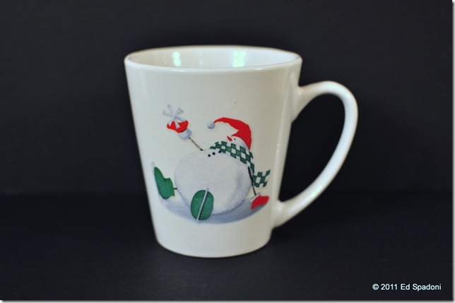 White cup against black background without exposure compensation