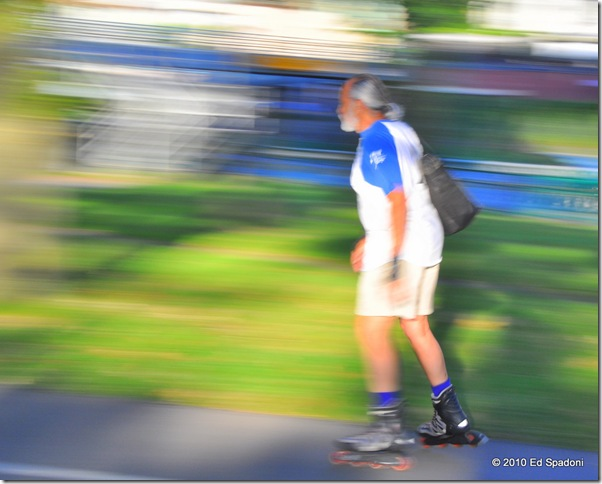 Panning a roller blading man in the park
