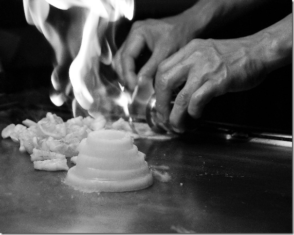 Hibachi chef cooking in bw by Kara Stewart