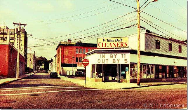 Street scene of a dry cleaner, In by 11, 2 Guys Photo