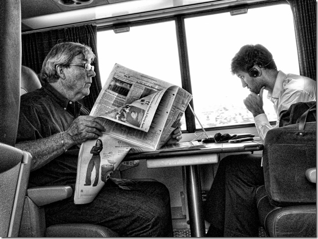 Two men commuting on a train