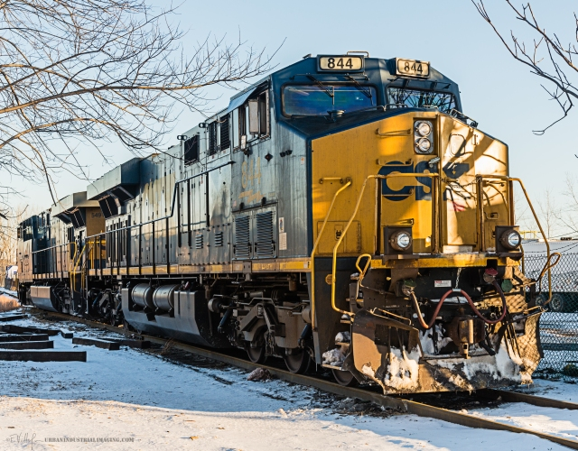 """While shooting the Pulaski Skyway last month, I drove around scouting the area for anything notable and """"found"""" this engine idling just outside the Kearny yard.  Since the area is totally accessible, I parked and took a number of shots, handheld.  I've always wanted a """"winter-y"""" shot of a train in the snow…this is it."""